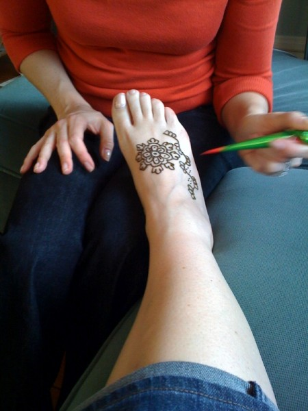 foot-photo. As it dries, the color sets and the left over henna paste begins